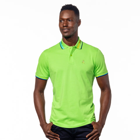 Model wearing bright green polo with striped collar.