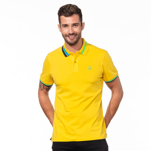 Model wearing bright yellow polo with block-striped collar.