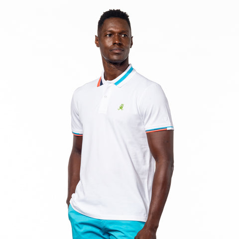 Model wearing white polo with block-striped collar.