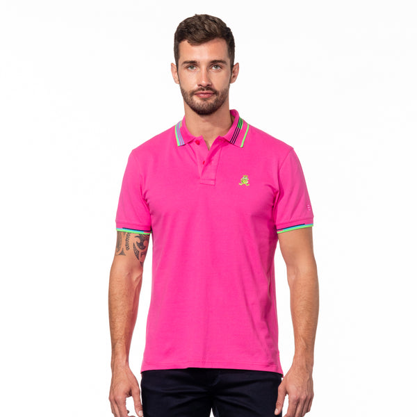 Model wearing fuchsia polo with striped collar.