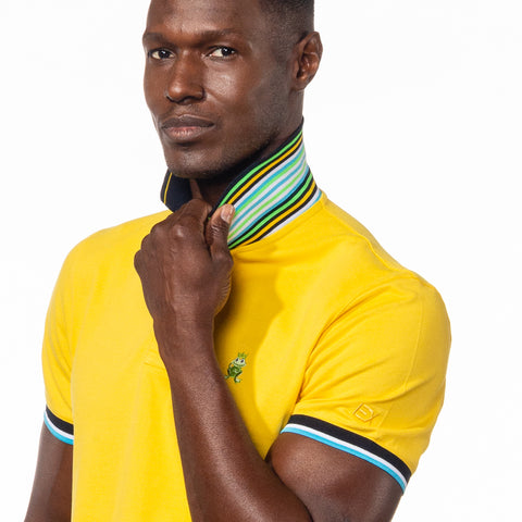 Model wearing bright yellow polo with flipped, striped collar.