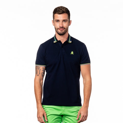 Model wearing navy blue polo with striped tipped collar, matching ribbed armbands, and embroidered green frog mascot.