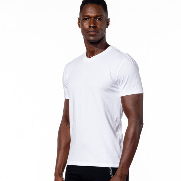 Model in white, short-sleeve cotton v-neck.