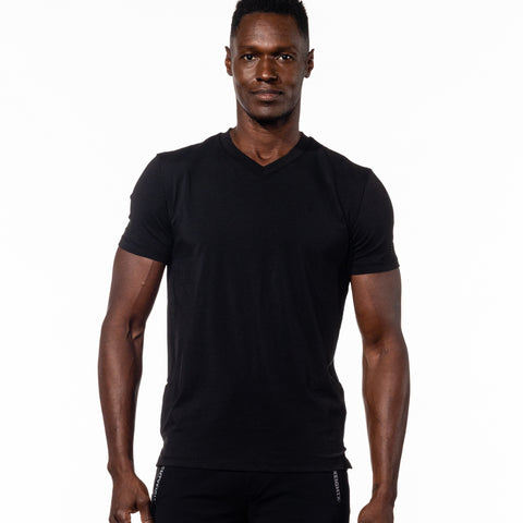 Model in black, short-sleeve cotton v-neck.
