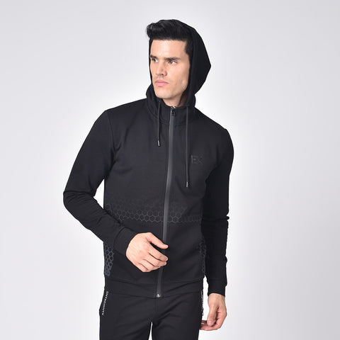 "Model in black cotton hoodie with drawstring hood; gradient honeycomb print; full front-zip; front pockets; and silicone ""EX"" logo on chest."