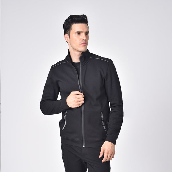 Model in black, cotton track jacket with hidden, full front-zipper; grey piping; and logo-lined side zip-pockets.