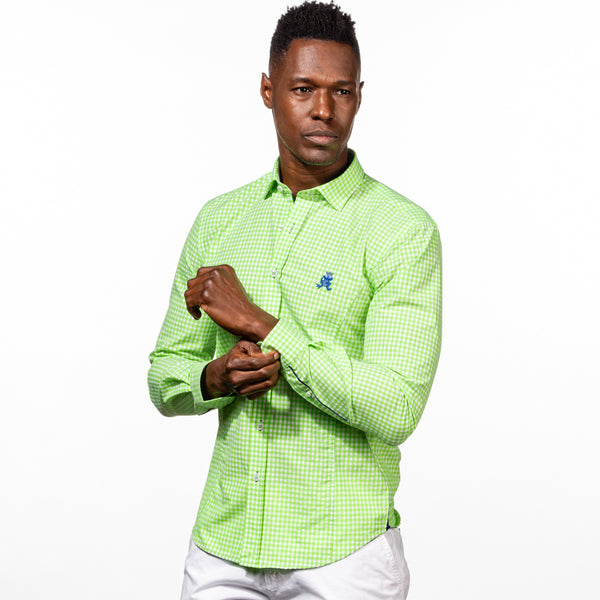 Model in bright-green gingham button up with navy-blue trim and royal blue embroidered frog.