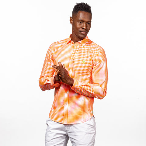 Model in bright-orange gingham button up with green trim, and green embroidered frog.