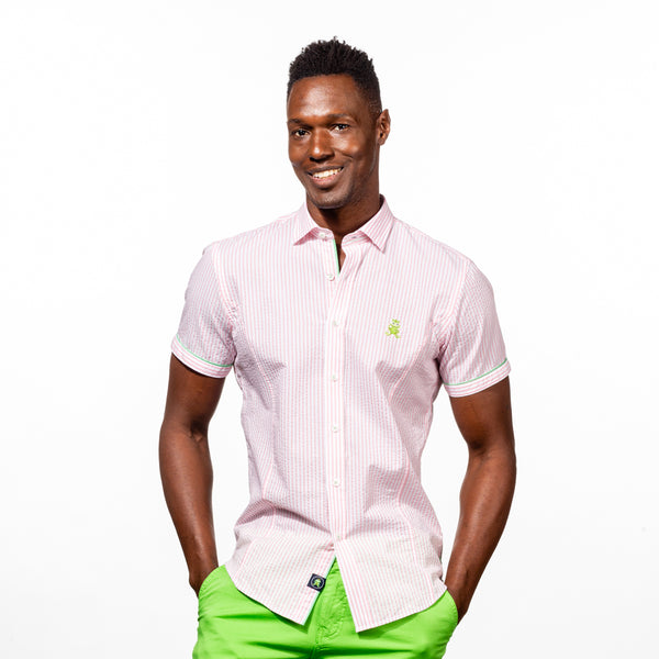 Model in short-sleeve, blue-striped seersucker button up with green trim; green, embroidered frog; and green gusset.