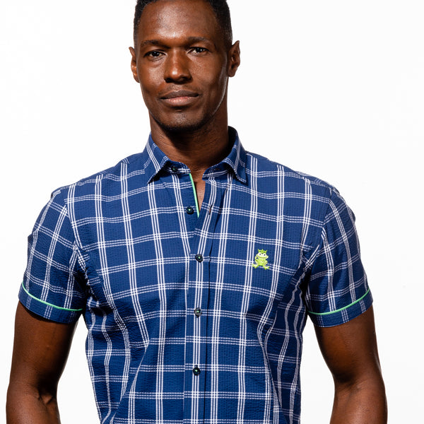 Model in short-sleeve, navy-blue plaid seersucker button up with green trim; green, embroidered frog; and navy-blue buttons.