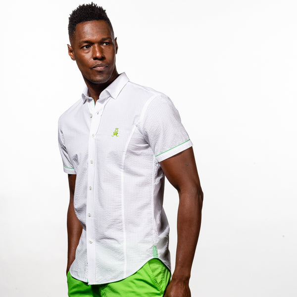 Model in short-sleeve, white seersucker button up with green trim; green, embroidered frog; and green gusset.
