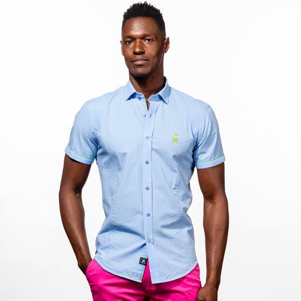 Model in short-sleeve, light-blue seersucker button up with green trim; green, embroidered frog; and blue buttons.