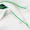 Detail of white seersucker's collar, green trim, and white buttons.