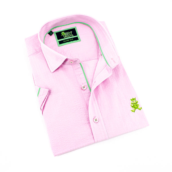 Folded short-sleeve, light-pink seersucker button up with green trim; green, embroidered frog; and pink buttons.