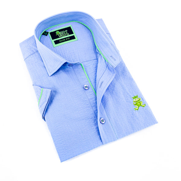 Folded short-sleeve, light-blue seersucker button up with green trim; green, embroidered frog; and blue buttons.