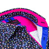 Close up of printed collar and hot pink and royal blue trim.