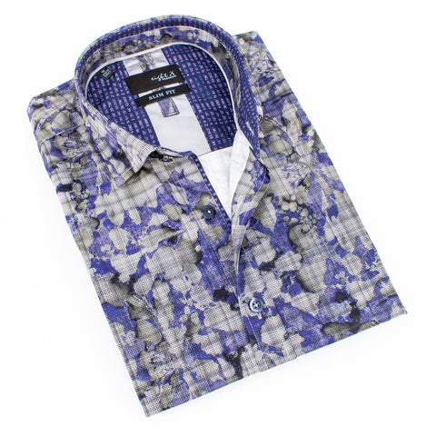 Folded button-up with abstract navy and gray digital print design.