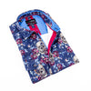 Folded navy button up with skull and floral digital print. Features blue trim.
