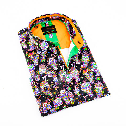 Folded black button up with festive skull print and orange trim.