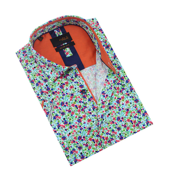Folded white button-up with multi-color small floral print and orange trim.