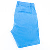Folded turquoise shorts with back welt pocket.