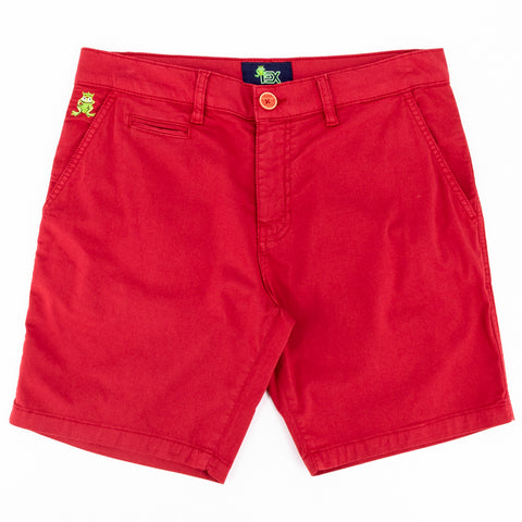 Flat-lay of bright-red shorts with two front pockets; one welt pocket; and green embroidered frog mascot on right front-pocket.