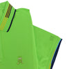 Detail of bright green polo's ribbed armbands with blue, yellow, and navy stripes.