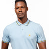 Model in light-blue polo with tipped collar, two-button placket, and striped, ribbed armbands. Featuring embroidered gold frog mascot and embroidered EX Logo on left sleeve.