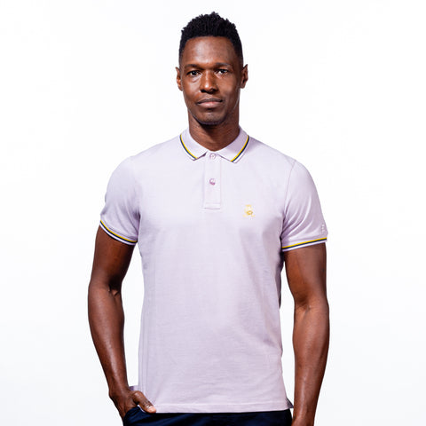 Model in lilac polo with tipped collar, two-button placket, and striped, ribbed armbands. Featuring embroidered gold frog mascot.