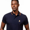 Model in navy-blue polo with tipped collar, two-button placket, and striped, ribbed armbands. Featuring embroidered gold frog mascot.