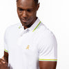 Model in white polo with tipped collar, two-button placket, and striped, ribbed armbands. Featuring embroidered gold frog mascot and embroidered EX Logo on left sleeve.
