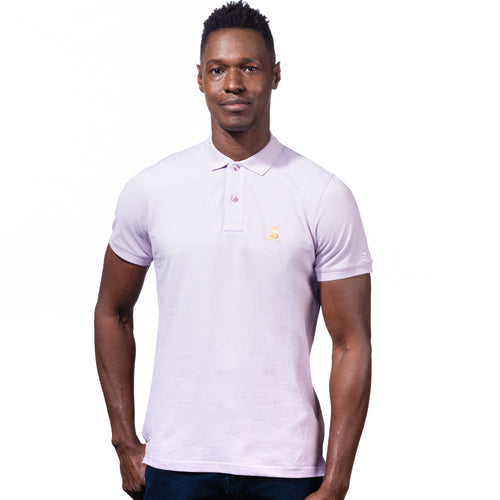 Model in lilac polo with two-button placket, ribbed armbands, and embroidered gold frog mascot.