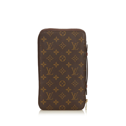 LOUIS VUITTON MONOGRAM DAILY TRAVEL ORGANIZER CLUTCH BAG  Shop online the best value on authentic designer used preowned consignment on Leef Luxury.