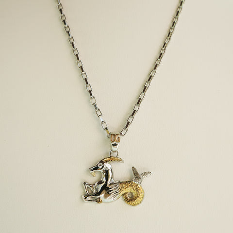 DOLCE & GABBANA ZODIAC CAPRICORN STERLING SILVER PENDANT NECKLACE  Shop online the best value on authentic designer used preowned consignment on Leef Luxury.