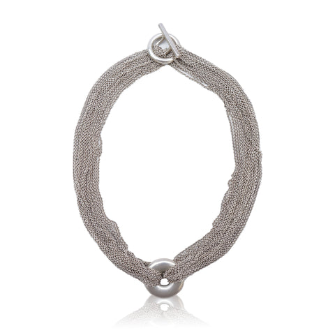 TIFFANY & CO. STERLING SILVER MESH CIRCLE NECKLACE Shop online the best value on authentic designer used preowned consignment on Leef Luxury.