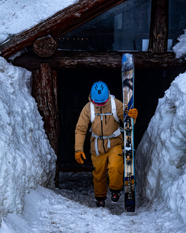 skier leaving hut with best backcountry skis the prospector