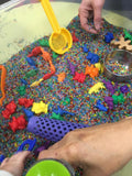 Sensory Rice for scooping and grabbing with additional coloured counters for hiding and collecting