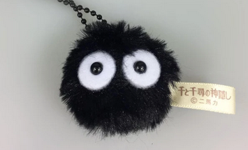 A fluffy black ball with wide eyes, attached to a black balled chain.