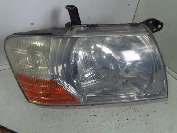03 - 07 MITSUBISHI SHOGUN MK3 OFF SIDE HEADLIGHT HEAD LAMP FACELIFT OSF #1906