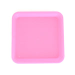 Silicone rolling tray in pink, perfectly square.