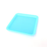 Silicone rolling tray in blue, perfectly square. Side view.