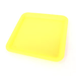 Silicone rolling tray in yellow, perfectly square. Side view.