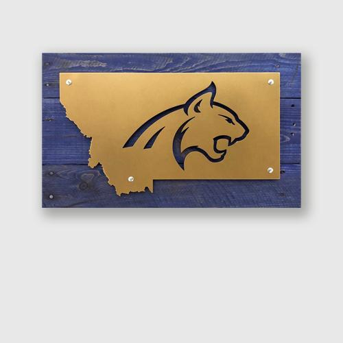 Bobcat head design in metal on blue stained pallet