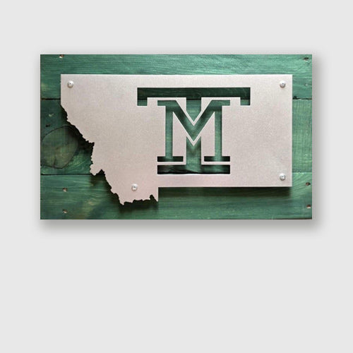 Montana Tech logo engraved in metal sign on upcycled pallet