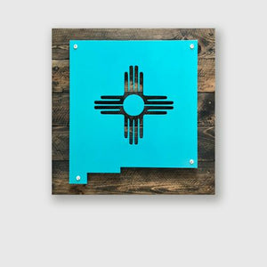New Mexico state shape with Zia Sun in metal on upcycled wood decorative sign