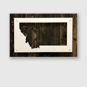Metal wall sign of the state of Montana on upcycled wood