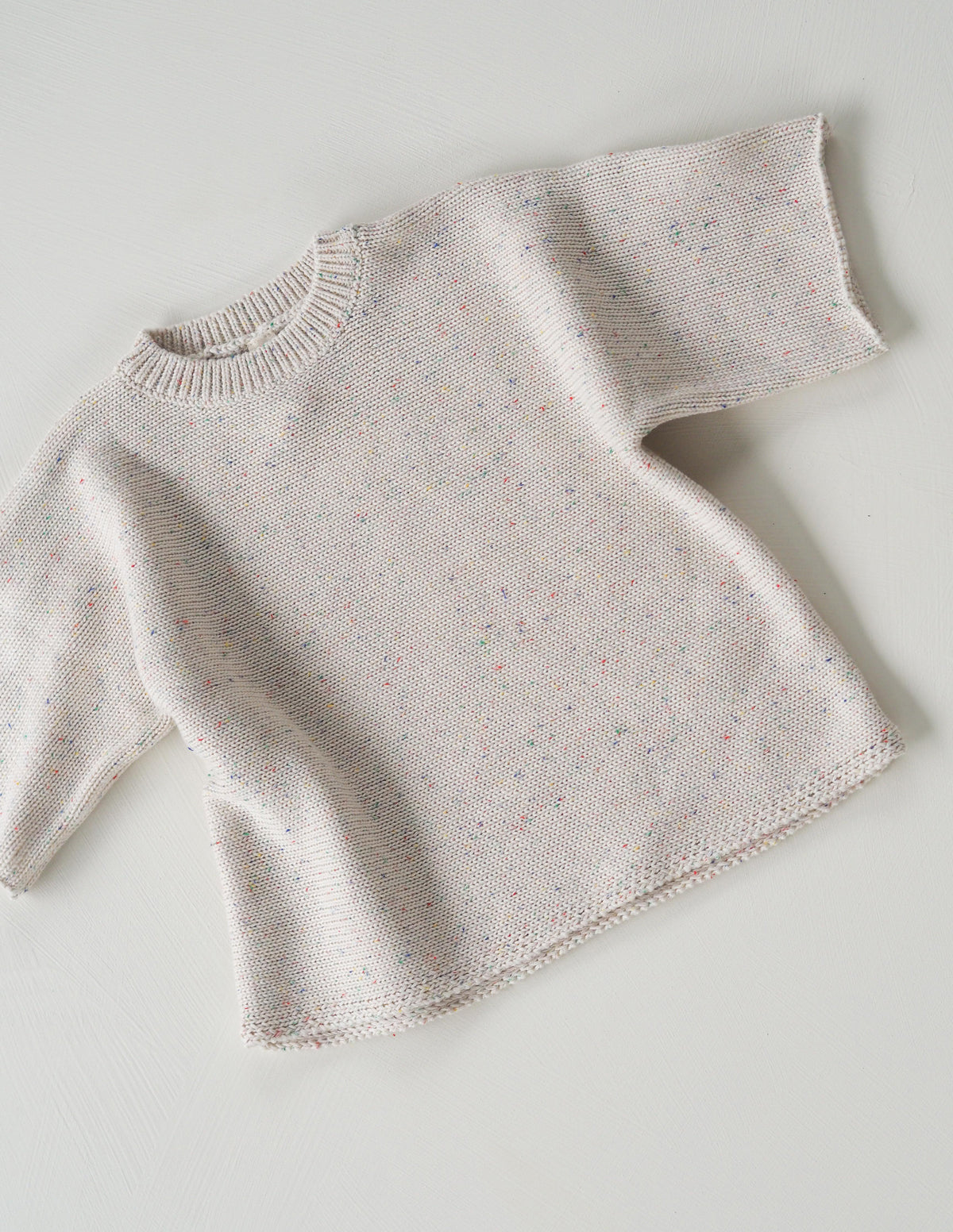 The original cream sprinkle knit tee