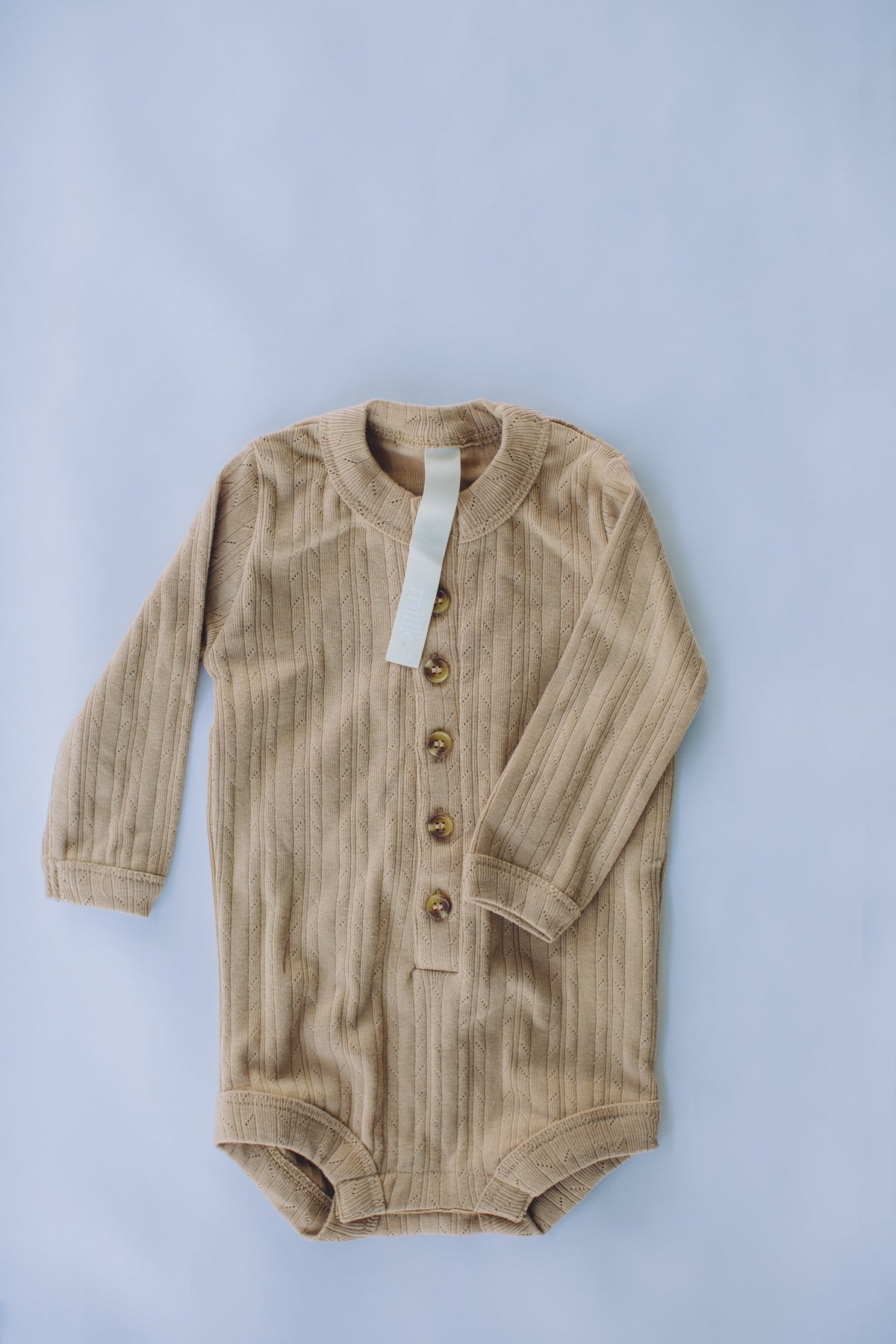 the base seasonal onesie - tan