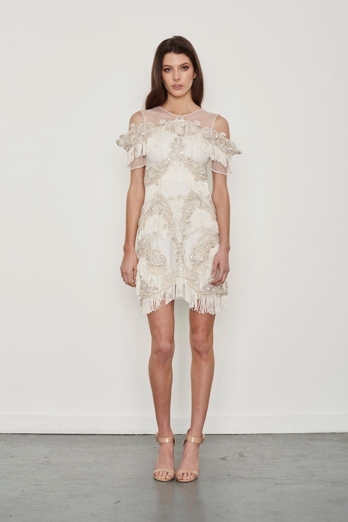 Hire the Thurley Almost Famous White fully beaded mini dress with fringe tassels along the hem creating a Gatsby look.