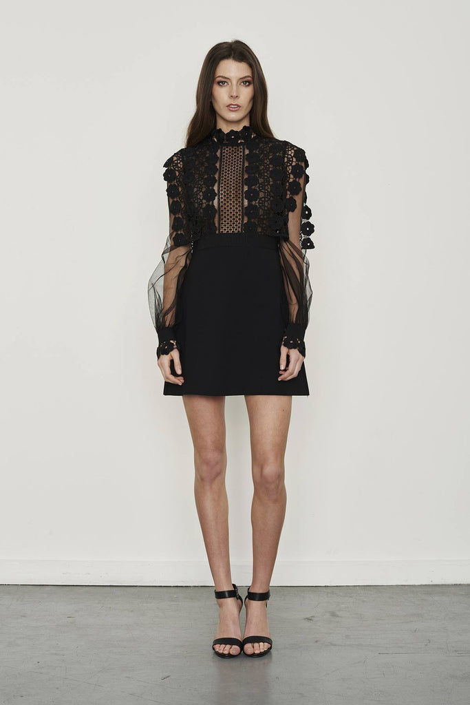 Front view of the self portrait balloon sleeve dress featuring sheer long sleeves and lace detailing at bust.